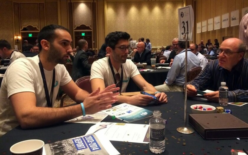 Nestdrop founders Roddy Radnia, left, and Michael Pycher pitch their concept for a user-friendly app to order marijuana and alcohol deliveries to investors at a marijuana business conference in Nevada.