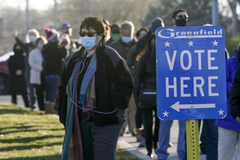Voters waiting in line outside a polling center in Greenfield, Wis.