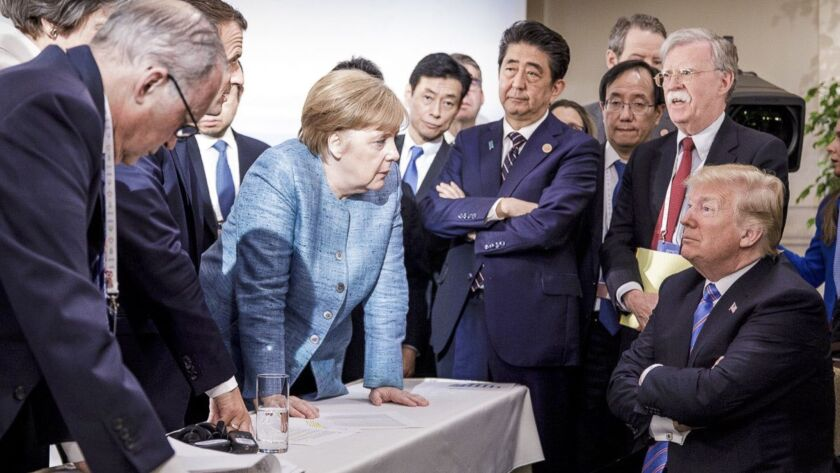 In this photo made available by the German Federal Government, German Chancellor Angela Merkel, cent