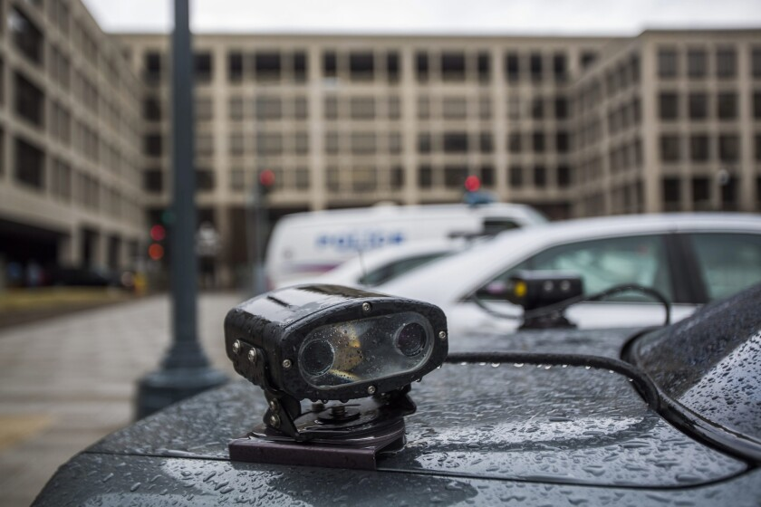An automated license plate reader is mounted to the back of a police car in Washington.