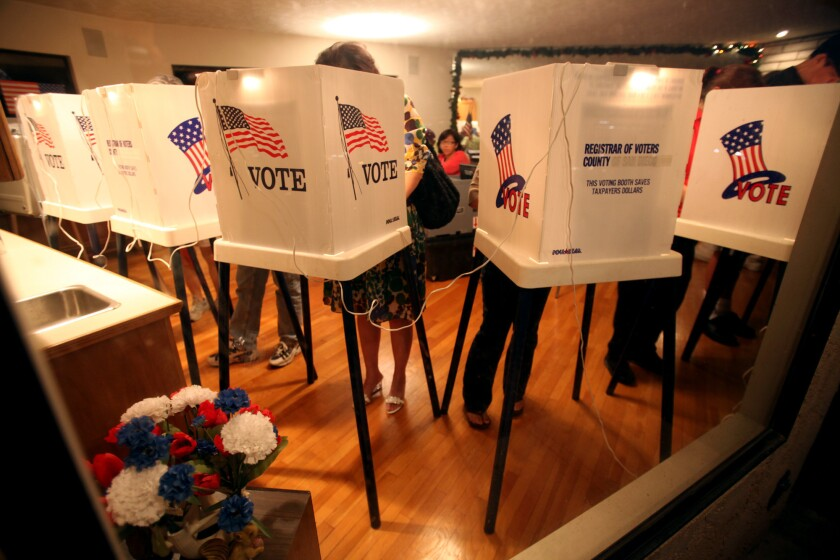 Voters cast their ballot at a polling site in South Pasadena.