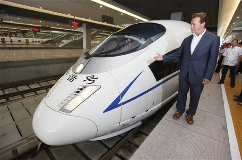 California Gov. Arnold Schwarzenegger inspects a China's high-speed train at Hongqiao Railway Station in Shanghai, China, Sunday, Sept. 12, 2010. Schwarzenegger is riding the rails, China's new high speed train lines, engaging in a little window shopping while peddling Californian exports and touri