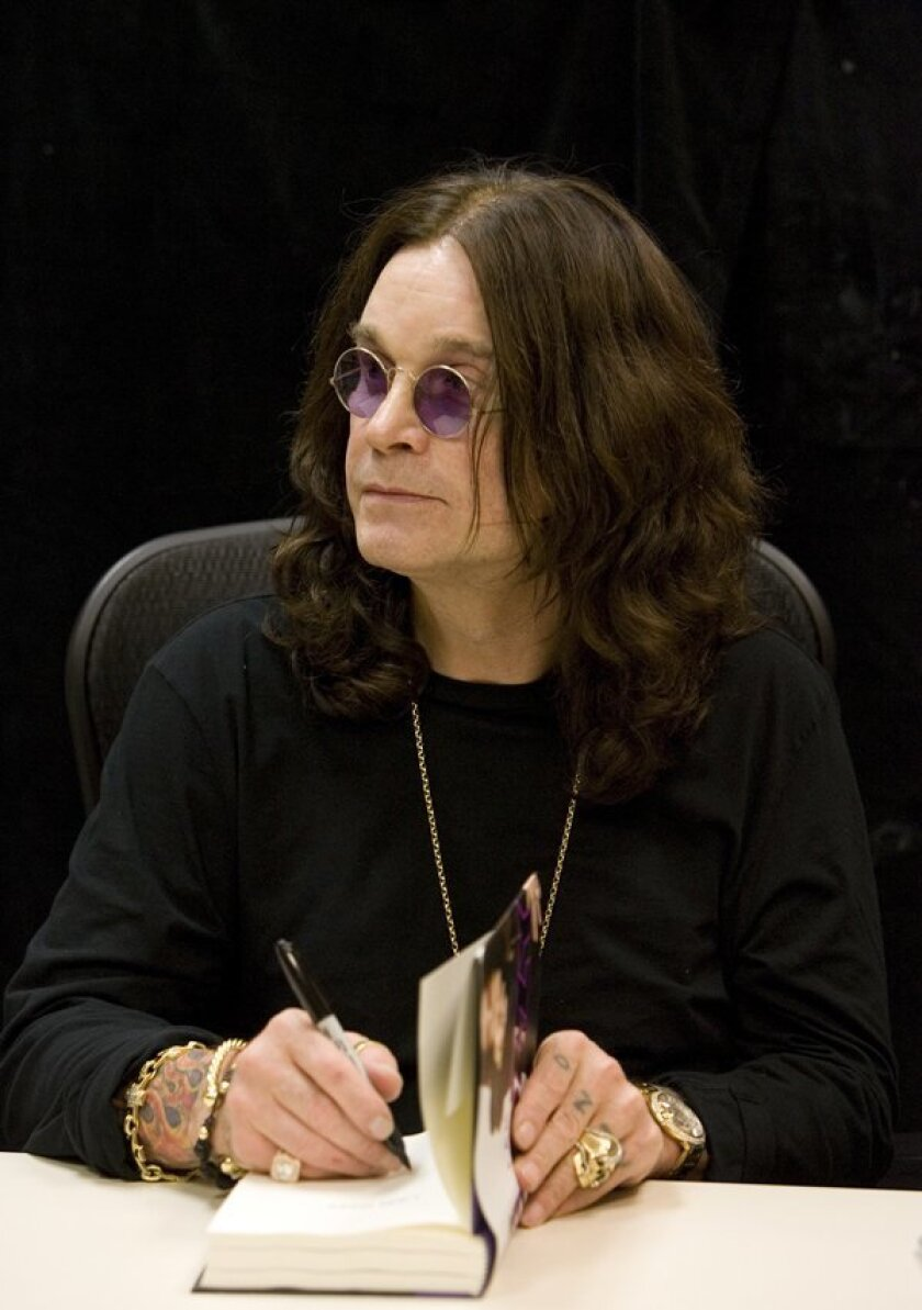 Ozzy Osbourne signs a copy of his autobiography at Warwick's in La Jolla in 2010. The ailing rock legend on Thursday announced that he is postponing all of his 2019 concert dates.