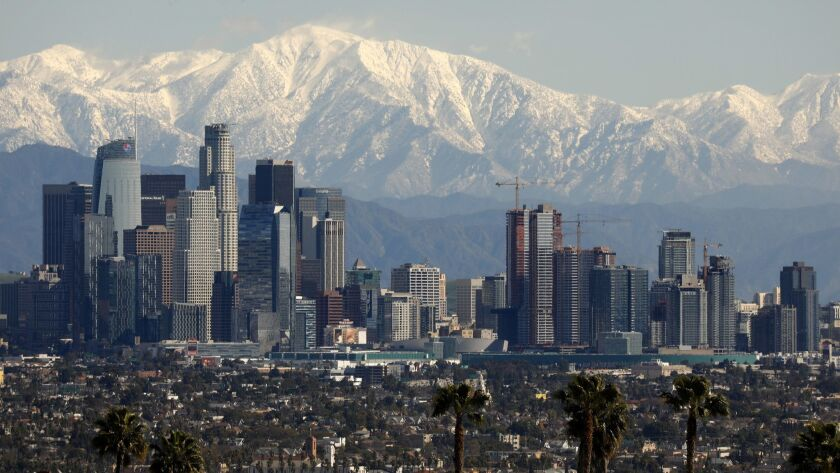 San Gabriel mountains covered with snow are a rare but beautiful backdrop above downtown Los Angeles earlier this month.
