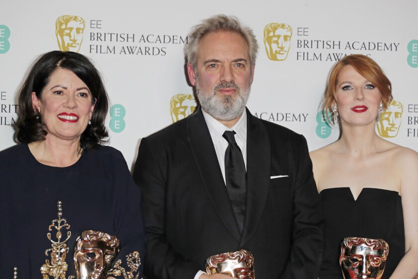 Producer Pippa Harris, from left, writer-director Sam Mendes and co-screenwriter Krysty Wilson-Cairns, winners of the outstanding British film award for '1917,' in the winners room at the British Academy Film Awards in London on Feb. 2.