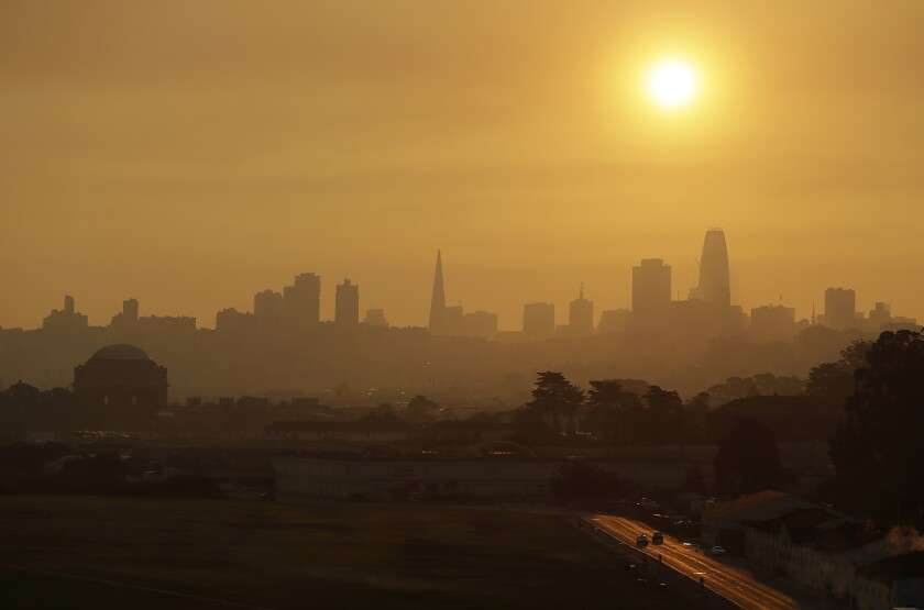 Smoke and haze from wildfires hovers over the San Francisco skyline Thursday.