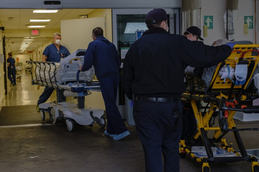 Patients arrive and are screened for COVID-19 symptoms at the medic staging area before entering the Sharp Memorial Hospital in San Diego in April.