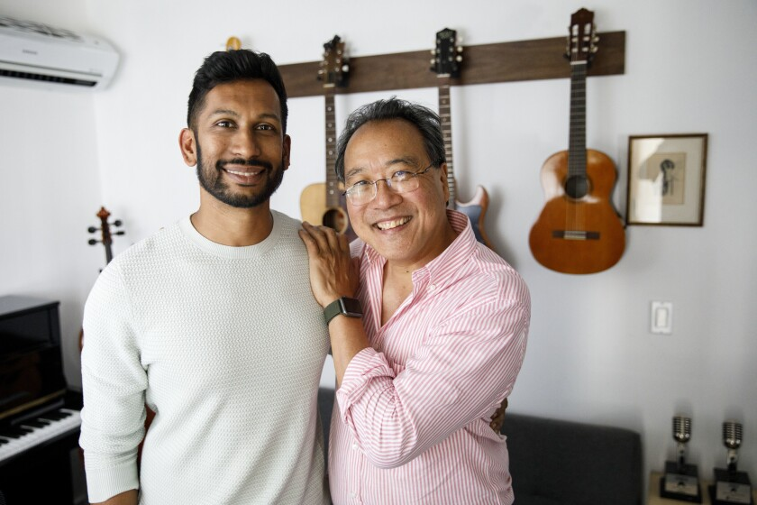 Hrishikesh Hirway, founder of the Song Exploder podcast, and Cellist Yo-Yo Ma stand for a portrait i