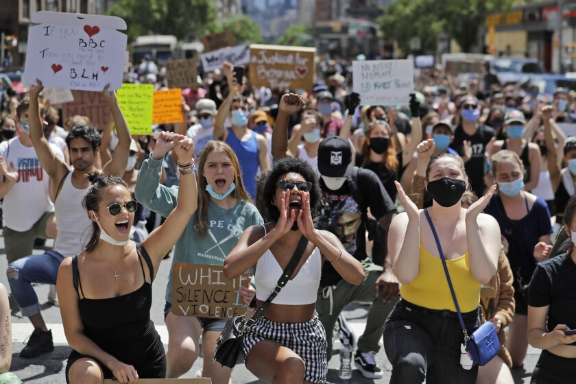 Protesters, many of them young people, march through the streets of Manhattan on June 7.