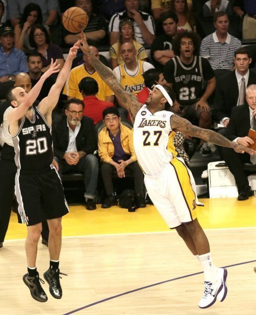 Lakers center Jordan Hill blocks a shot by Spurs guard Manu Ginobili in the second half of Game 4 on Sunday at Staples Center.