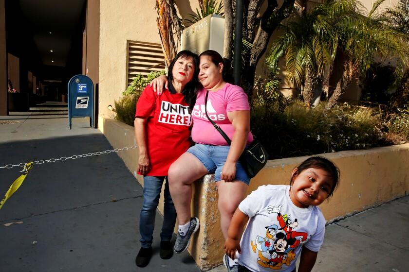 A Latina mother, daughter and grandmother
