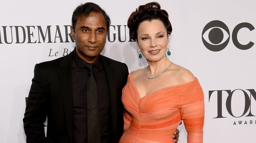 Scientist Shiva Ayyadurai and actress Fran Drescher quietly wed. According to People magazine, she wore Badgley Mischka, he wore Ralph Lauren.