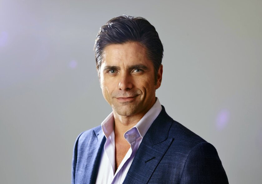 """FILE - In this Aug. 6, 2015 file photo, actor John Stamos, from the new comedy """"Grandfathered,"""" poses for a portrait during the Fox 2015 Television Critics Association Summer Press Tour in Beverly Hills, Calif. An attorney for Stamos entered a no contest plea on Tuesday, Nov. 24, 2015, to a misdemeanor charge of driving under the influence of a drug filed after the actor's arrest in Beverly Hills in June. A Los Angeles judge sentenced Stamos to three years on probation and attend 52 Alcoholics Anonymous meetings. (Photo by Matt Sayles/Invision/AP, File)"""