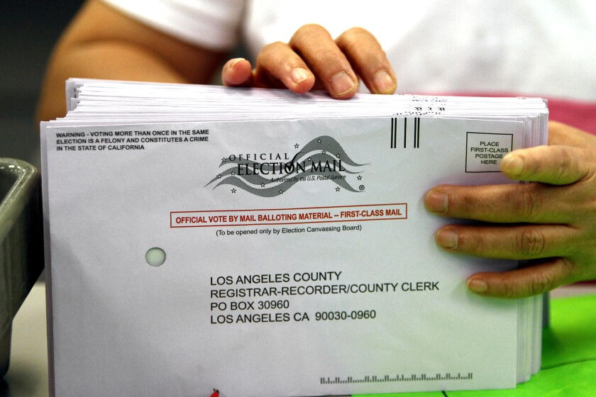 A clerk sorts mail-in ballots at the Los Angeles County Registrar's office in Norwalk.
