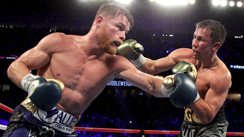 Canelo Alvarez, left, exchanges blows with Gennady Golovkin during their Sept. 16 fight at T-Mobile Arena in Las Vegas.