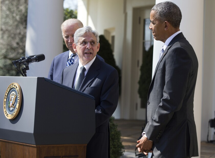 Merrick Garland speaks as President Obama and Vice President Joe Biden listen during the announcement of Merrick's nomination to the Supreme Court at the White House on March 16.
