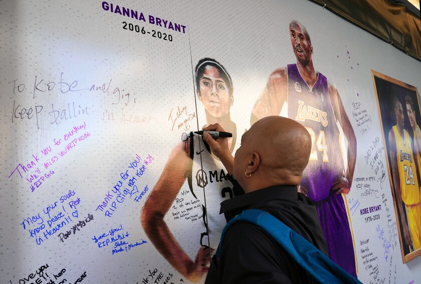 Fans honor Kobe Bryant and his daughter Gianna at an art installation wall in the plaza across from Golden 1 Center in Sacramento on Feb. 2, 2020.
