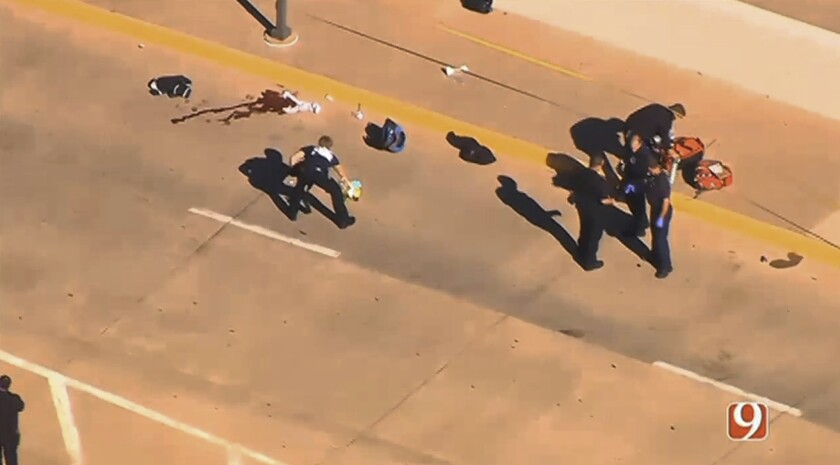 An image taken from a news helicopter video shows police responding to a shooting at Will Rogers World Airport in Oklahoma City on Tuesday.