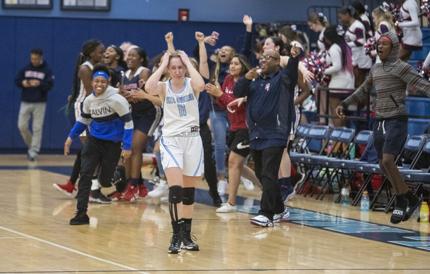 Corona del Mar's Tori Gyselaar walks off the court following a 34-28 loss to Lancaster in a CIF Southern Section Division 3AA quarterfinal playoff game on Wednesday in Newport Beach.