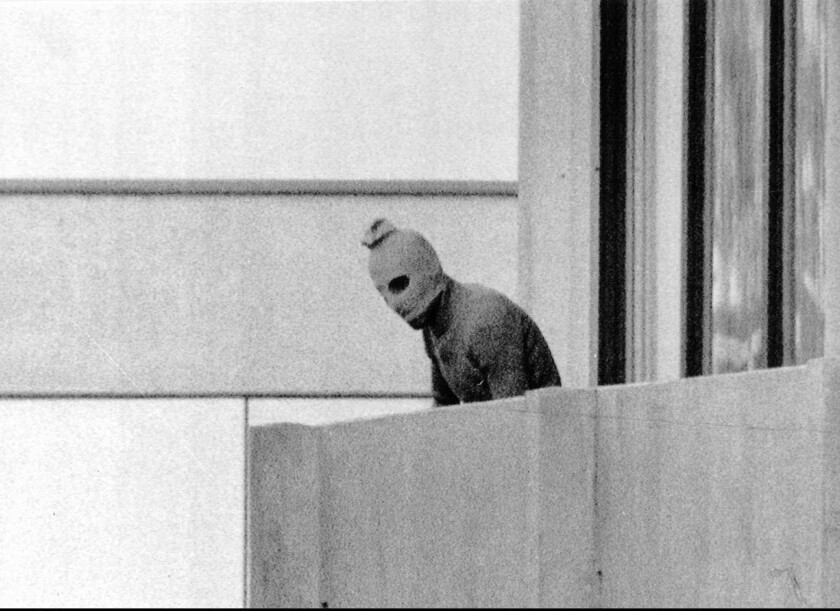 A terrorist appears on a terrace at the Olympic village in Munich in 1972, when 11 Israelis were killed.