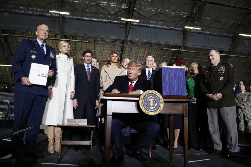 President Trump signs the National Defense Authorization Act for Fiscal Year 2020 at Andrews Air Force Base, Md., on Dec. 20.