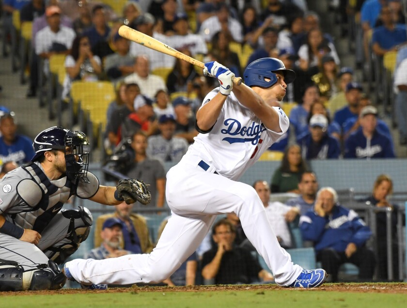 Dodgers shortstop Corey Seager hits a two-run double.