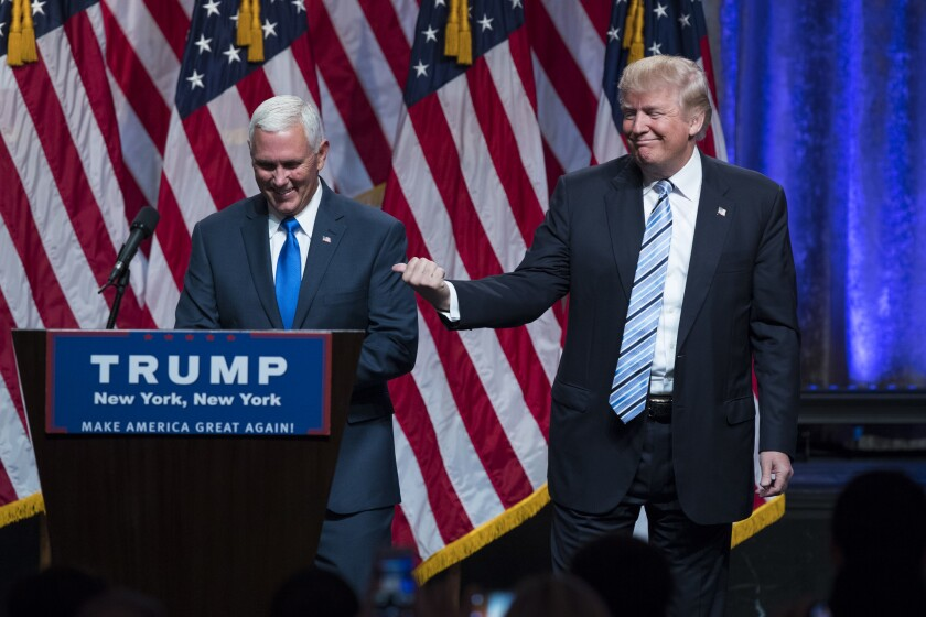 Presumptive Republican nominee Donald Trump introduces his running mate, Indiana Gov. Mike Pence, at an event in New York.