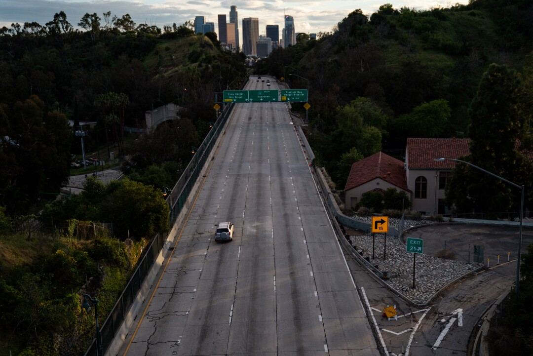 Rush hour on the 110 Freeway doesn't look like it normally does, viewed from a bridge in Elysian Park on April 10. As the Southland enters the Easter holiday weekend, Los Angeles County health officials warned the region needs to increase social distancing to slow the coronavirus spread.