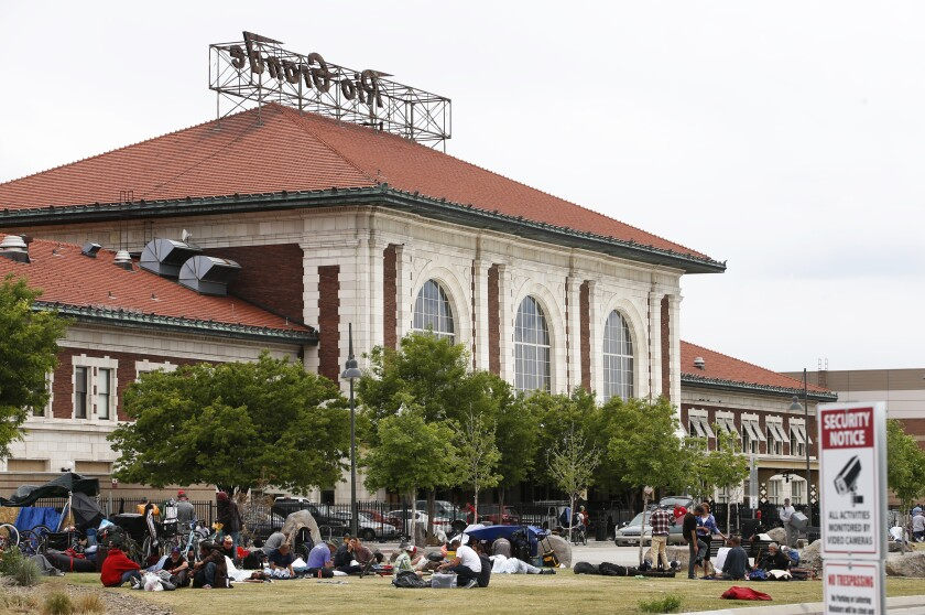 People camp behind the historic Rio Grande Train Station in Salt Lake City in 2017.