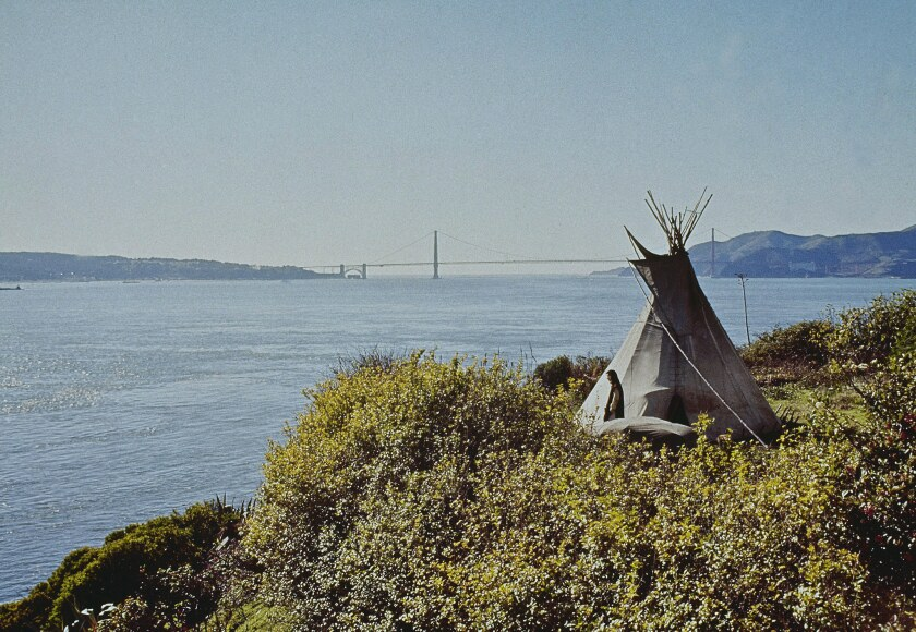 John Trudell, a Sioux poet, actor, activist and more, stands next to a teepee on one end of Alcatraz Island in San Francisco, in November 1969.