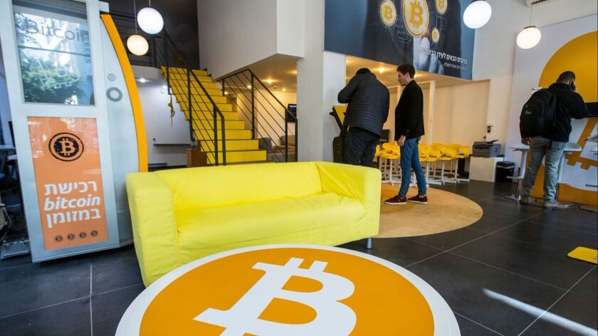 "Israelis buy Bitcoins at the cryptocurrency ""Bitcoin Change"" shop in Tel Aviv. Recently, the price of the electronic currency has stabilized."