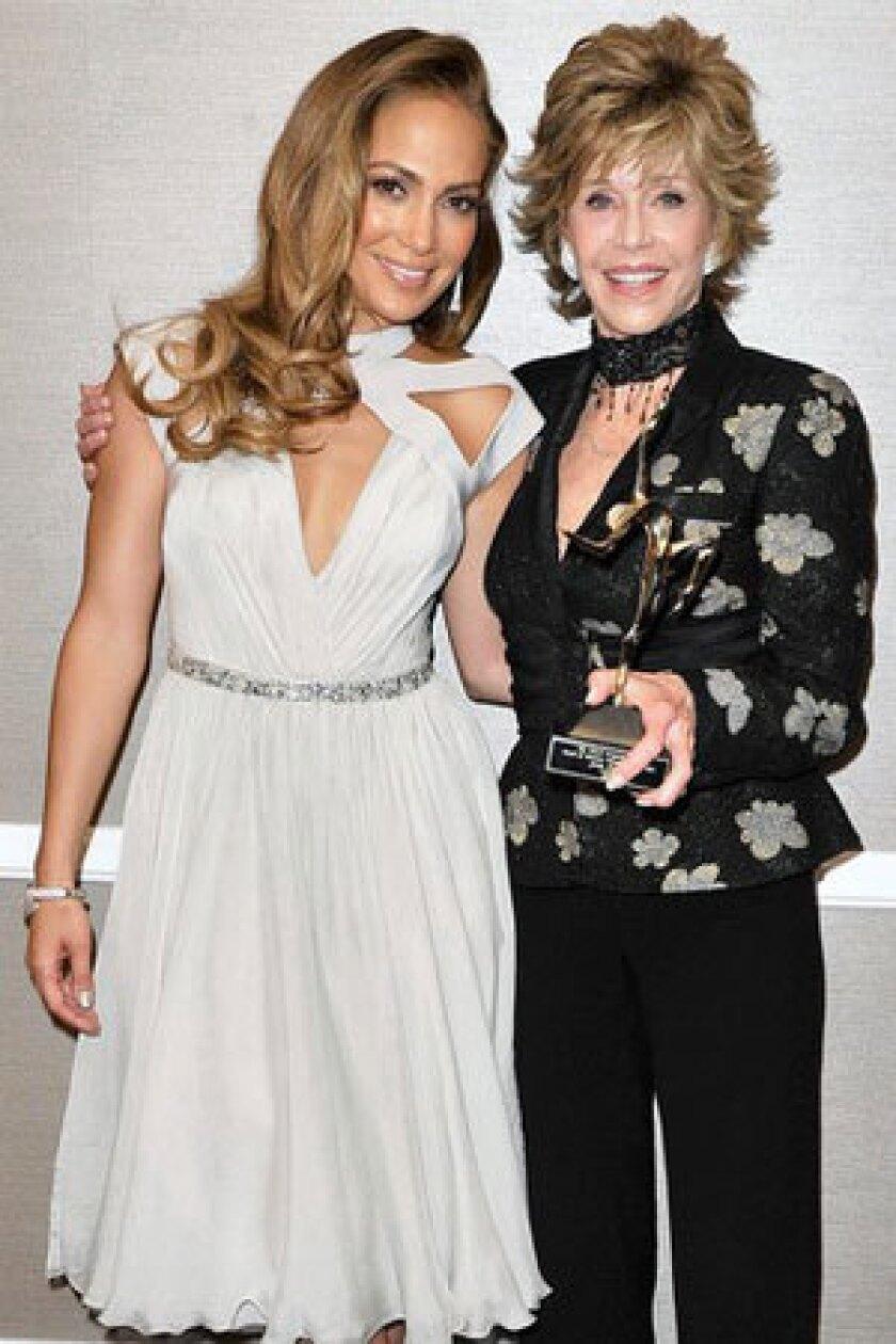 Presenter Jennifer Lopez, left, and recipient Jane Fonda backstage at the UCLA Longevity Center's event.