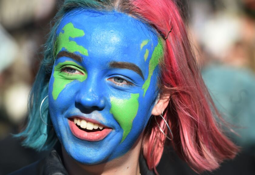 A student takes part in a climate change protest in London in February.