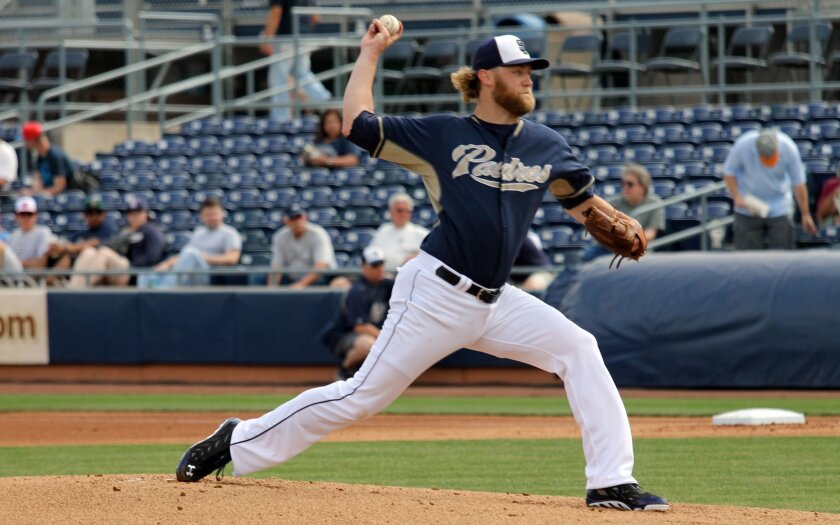 Padres pitcher Andrew Cashner throws against the Mariners in their spring training game in Peoria, Ariz.