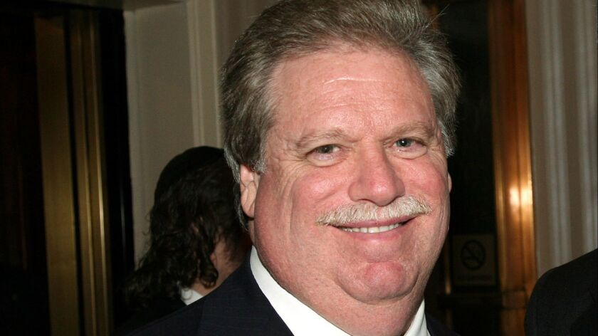 FILE - In this Feb. 27, 2008, file photo, Elliott Broidy poses for a photo at an event in New York.