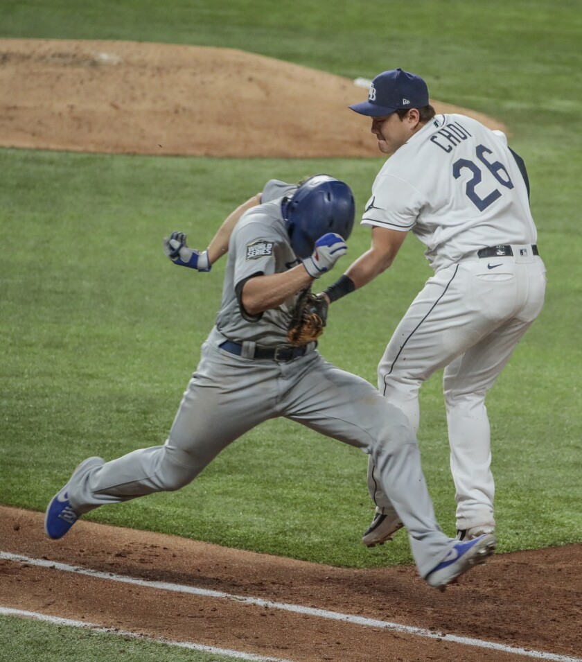 Corey Seager is tagged out by Rays first baseman Ji-Man Choi.