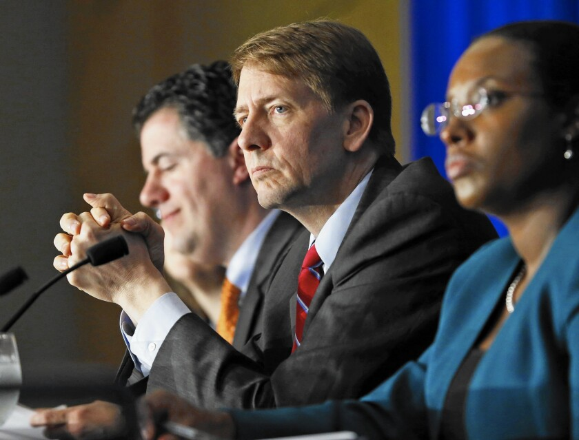 The Consumer Financial Protection Bureau recently slapped Florida's Clarity Services with an $8-million fine for illegally accessing the credit files of thousands of consumers. Above, bureau director Richard Cordray, center.