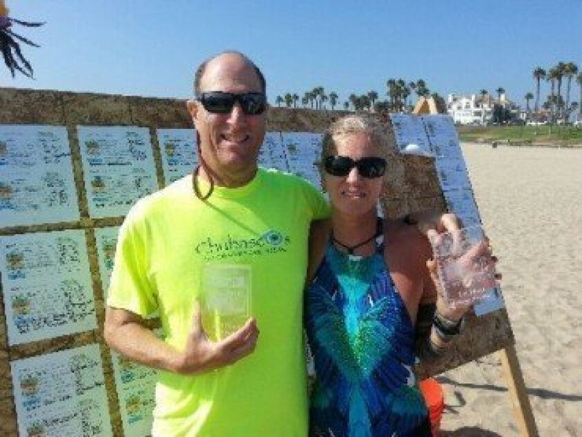 Dr. Bruce Robbins and Briguitte Linn Wiedemeyer with their awards at the 2014 Huntington Beach Bodysurf Championship.