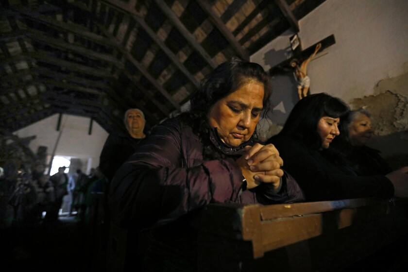 MISSION, TEXAS--FEB. 8, 2019--Elizabeth Garcia, center, and Anna Velasquez, right, pray during mass