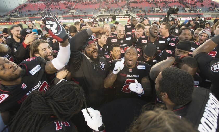 Ottawa Redblacks celebrate after defeating the Hamilton Tiger-Cats in the Canadian Football League East final, Sunday, Nov. 22, 2015, in Ottawa, Ontario. (Adrian Wyld/The Canadian Press via AP)