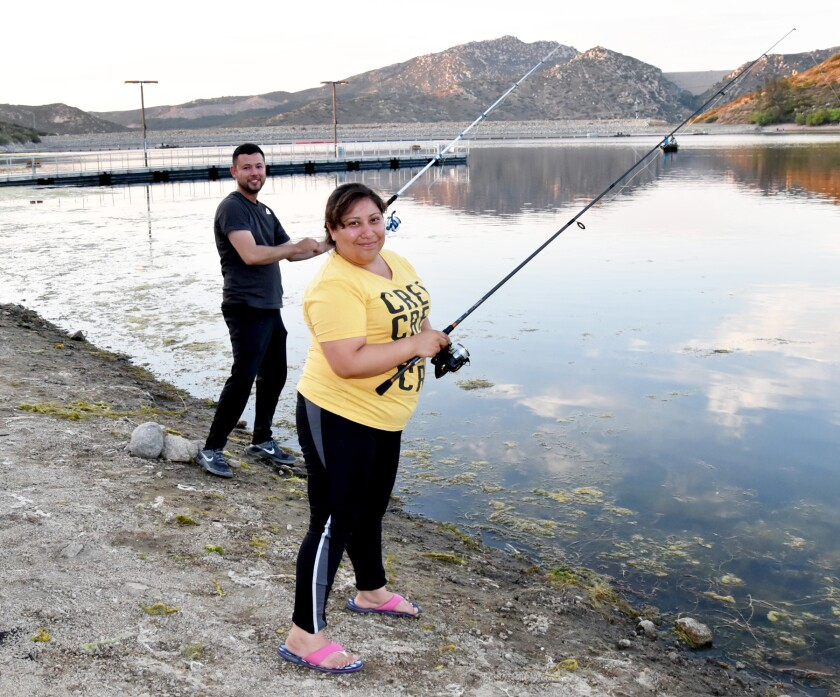 Abraham Rendon and Claudia Arellanes waiting for their catch. See more photos in the gallery below.