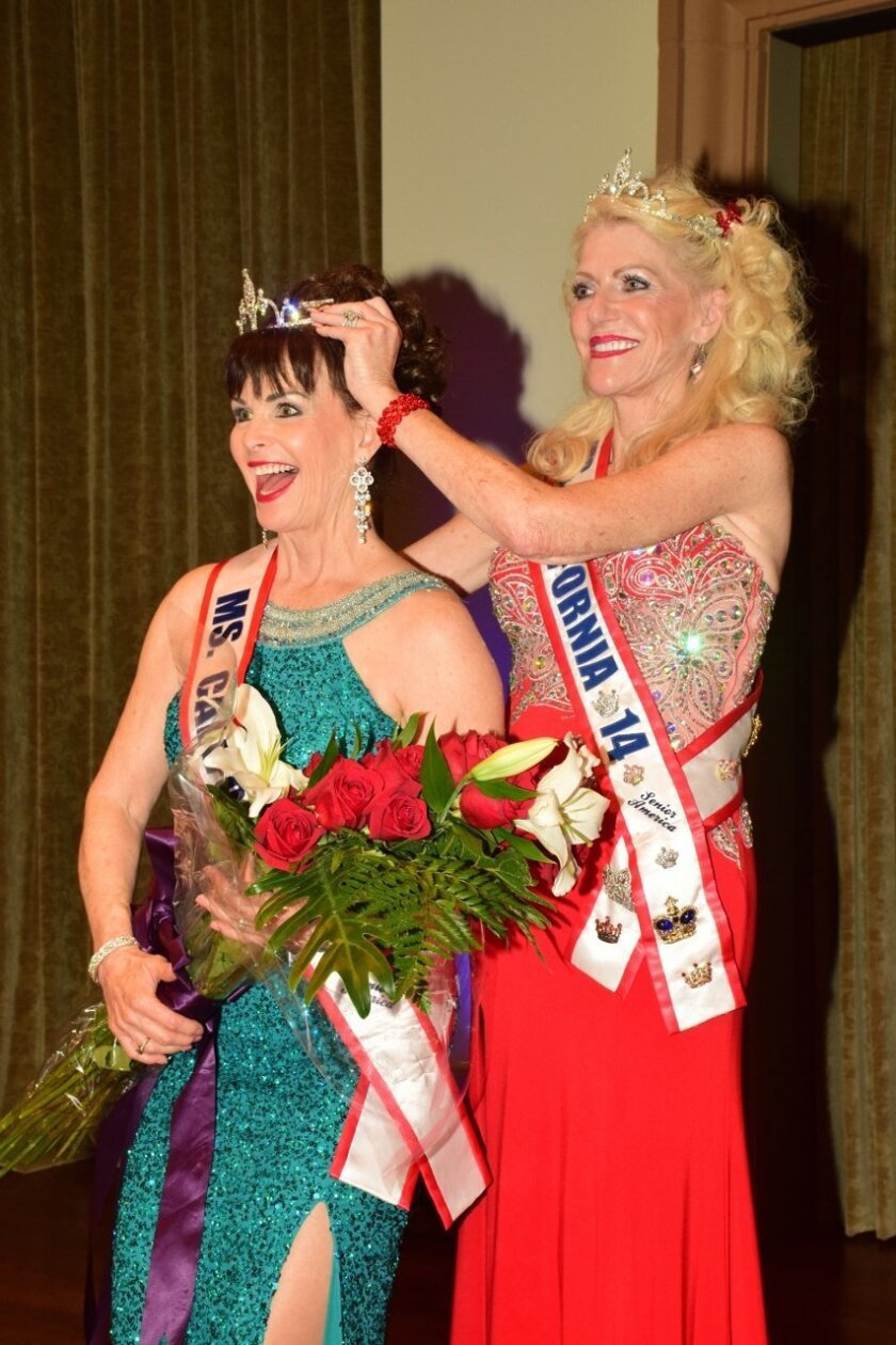 Ms. Senior California 2015 Reina Bolles receives her crown from last year's winner.