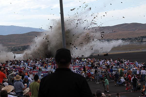 A P-51 Mustang airplane crashes into the edge of the grandstands at the Reno National Championship Air Races. The World War II-era fighter plane flown by a veteran Hollywood stunt pilot Jimmy Leeward plunged Friday into the edge of the grandstands during the popular air race, creating a horrific scene strewn with debris.