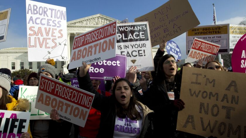 FILE - In this Jan. 18, 2019, file photo, abortion-rights activists protest outside of the U.S. Supr