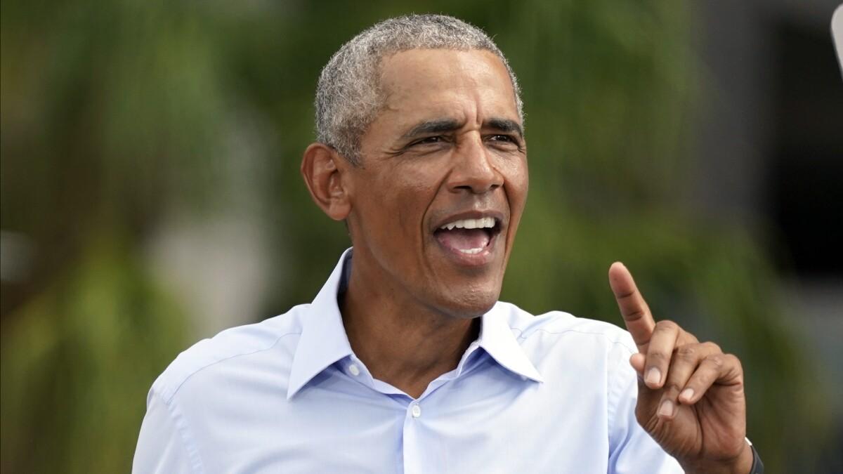Obama, unmuzzled, roasts Trump at Biden campaign rallies