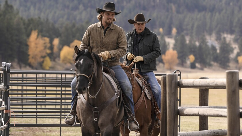 "Luke Grimes, left, and Kevin Costner in ""Yellowstone"" on Paramount."