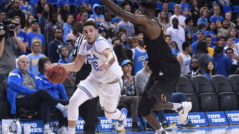 LOS ANGELES, CA - NOVEMBER 01: UCLA guard LiAngelo Ball (15) drives to the basket during an college