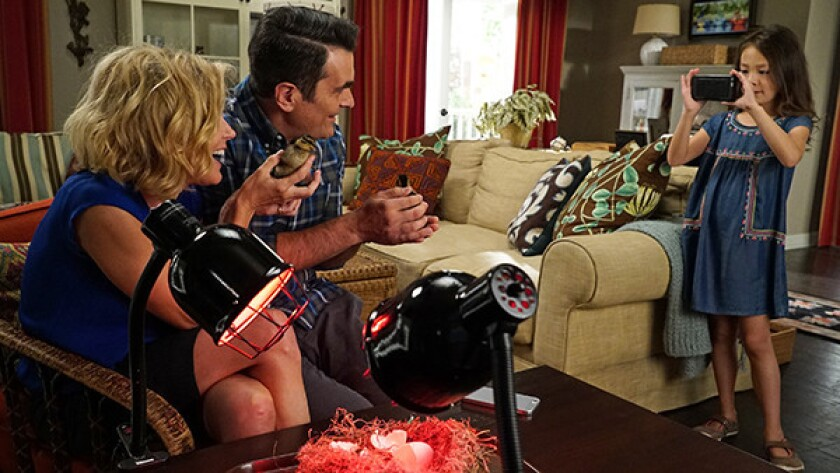 """Julie Bowen, left, Ty Burrell and Aubrey Anderson-Emmons in """"Modern Family"""" on ABC."""