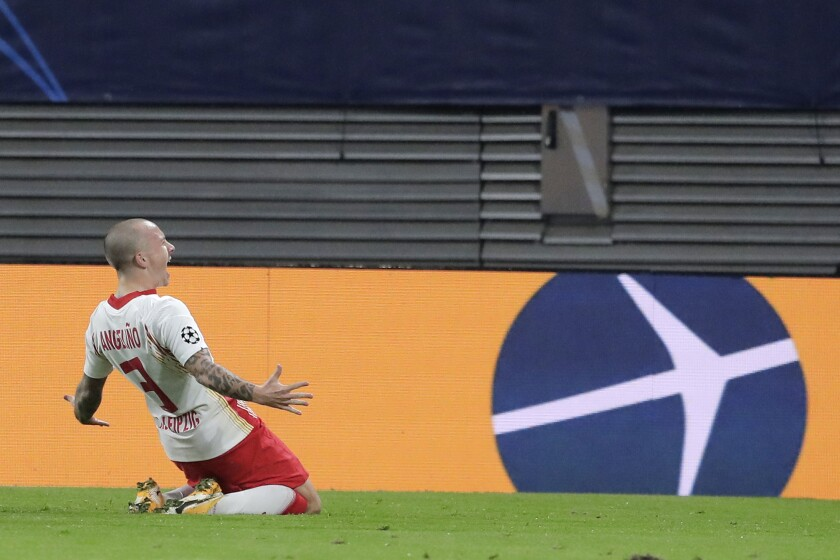 Leipzig's Angelino celebrates after scoring his side's opening goal during a Group H Champions League soccer match between RB Leipzig and Istanbul Basaksehir at the RB Arena in Leipzig, Germany, Tuesday Oct. 20, 2020. (AP Photo/Markus Schreiber)
