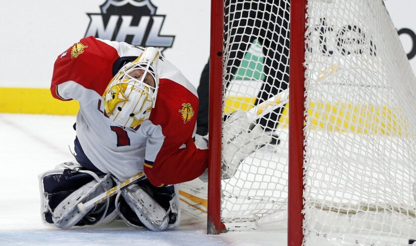Florida Panthers goalie Roberto Luongo (1) coils back as Los Angeles Kings defenseman Drew Doughty, not pictured, scores during the second period of an NHL hockey game in Los Angeles, Saturday, Nov. 7, 2015. (AP Photo/Alex Gallardo)